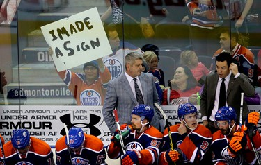 A fan holds up his sign behind the Edmonton Oilers bench during third period NHL action at Rexall Place in Edmonton, Alberta on October 21, 2015. Perry Mah/Edmonton Sun/Postmedia Network