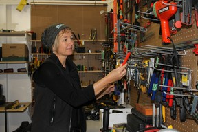 Ottawa Tool Library's co-founder Bettina Vollmerhausen looks through some of the 350 cataloged tools at 250 City Centre Ave.  JULIENNE BAY/Ottawa Sun