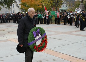 Nello Bortolotti of the Ottawa Italian Canadian Community Centre lays a wreath in Piazza Dante on Sunday, Oct. 25, 2015 during a ceremony honouring the  late Cpl. Nathan Cirillo. JULIENNE BAY/Ottawa Sun