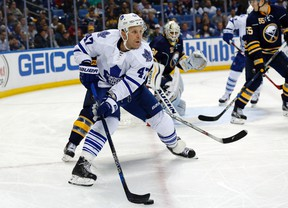 Toronto Maple Leafs center Leo Komarov brings the puck from behind the Buffalo Sabres net during the third period at First Niagara Center in Buffalo on Oct. 21, 2015. (Kevin Hoffman/USA TODAY Sports)