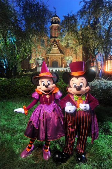 """Mickey and Minnie decked out in their newest Halloween party-wear in front of the Haunted Mansion at the Magic Kingdom in Lake Buena Vista, Fla.  It's all part of the fun that takes place when the Magic Kingdom hosts """"Mickey's Not-So-Scary Halloween Party."""" A separate ticket is required to attend.  KENT PHILLIPS/COURTESY DISNEY WORLD CO."""