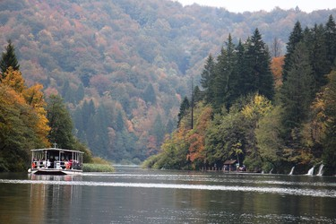Vibrant foliage and fabulous falls come with your free boat ride across crystal-clear Lake Kozjak during an autumn visit. BRIAN QUINN PHOTO