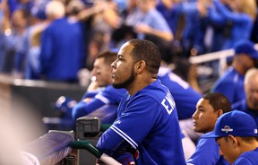 Edwin Encarnacion of the Toronto Blue Jays looks out from the dugout after losing to the Kansas City Royals during game 6 of the American League Championship Series at Kauffman Stadium in Kansas City, MO, USA. on Saturday October 24, 2015. Dave Abel/Toronto Sun/Postmedia Network
