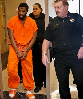 Cleveland County Sheriff's department escort Alton Nolen from the courtroom of Judge Lori Walkley during a break in his competency trail on Monday, Oct. 26, 2015, in Norman, Okla. Testimony resumed Tuesday in a non-jury trial to determine whether Nolan is mentally competent to be tried for first-degree murder. (Chris Landsberger/The Oklahoman via AP)