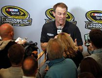 Driver Kevin Harvick answers a question during the NASCAR Sprint Cup series auto racing Eliminator Media Day in Charlotte, N.C., Tuesday, Oct. 27, 2015. The Panthers won 27-16. (AP Photo/Chuck Burton)