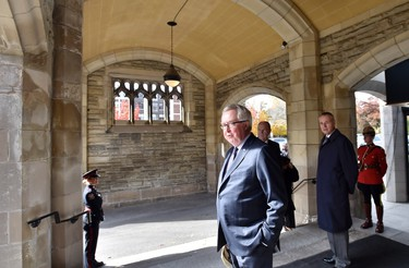 Former prime minister Joe Clark arrives for the funeral of former diplomat Ken Taylor in Toronto on Tuesday, Oct. 27, 2015. Taylor was Canada's ambassador to Iran in 1979 when he helped six Americans escape the country during the hostage crisis.THE CANADIAN PRESS/Nathan Denette