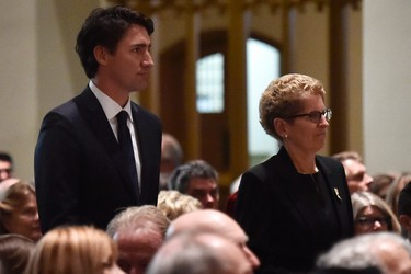 Prime Minister-designate Justin Trudeau and Ontario Premier Kathleen Wynne arrive for the funeral of former diplomat Ken Taylor in Toronto on Tuesday, Oct. 27, 2015. Taylor was Canada's ambassador to Iran in 1979 when he helped six Americans escape the country during the hostage crisis.THE CANADIAN PRESS/Nathan Denette