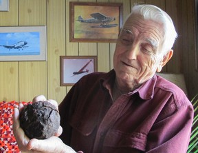 Lloyd Shales shows off a cannon ball from the Spanish galleon El Infante, which went down in 1733 in the Florida Keys. Shales recovered the artifact during a 1960 dive. (Patrick Kennedy/The Whig-Standard)
