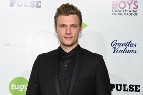"""In this Jan. 29, 2015 file photo, Nick Carter arrives at the """"Backstreet Boys: Show 'Em What You're Made Of"""" premiere at the Arclight Cinemas - Cinerama Dome, in Los Angeles.  (Photo by Rob Latour/Invision/AP, File)"""