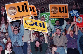 Yes supporters cheer during a speech by Bloc Quebecois Leader Lucien Bouchard at a junior college in Montreal Tuesday, Oct. 24, 1995. (THE CANADIAN PRESS/Ryan Remiorz)