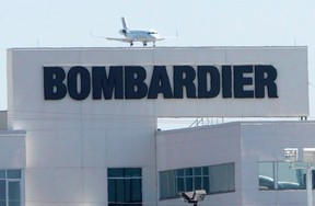 A plane comes in for a landing at a Bombardier plant in Montreal, Thursday, May 14, 2015. (THE CANADIAN PRESS/Ryan Remiorz)