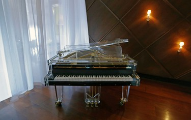 This photo taken Friday, Oct. 9, 2015, shows a piano that adorns an area of the lobby of the Hotel Delano South Beach in Miami Beach, Fla. The design ideals and social experience offered at the Delano have almost become industry standards, as major hotel chains have launched new �boutique� brands aimed at millennials and design-savvy travelers. (AP Photo/Alan Diaz)
