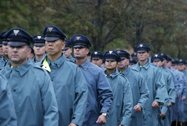 New York State Police officers march in the rain near the Greater Allen A.M.E. Cathedral of New York ahead of the funeral service for slain New York City Police (NYPD) officer Randolph Holder in the Queens borough of New York City, October 28, 2015. Holder's funeral comes more than a week after he was shot to death while on patrol in New York City's East Harlem neighborhood. He is the fourth New York City officer to be killed on duty in the last 12 months.   REUTERS/Brendan McDermid