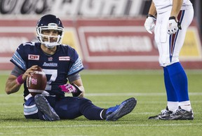 Toronto Argonauts quarterback Trevor Harris sits on the ground after being sacked by the Montreal Alouettes in Hamilton October 23, 2015. (REUTERS/Mark Blinch)