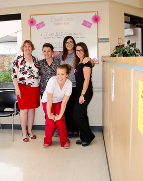 Dr. Bev Burton, Chalsey Peeters, Lais Morrow, Lisa Secretan,  and Ashley Conley of the Associate's Clinic pose in front of the Breast Cancer information board. The staff are on a mission to get the word out about breast cancer screening during the month of October. John Stoesser photo/Pincher Creek Echo.
