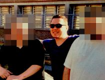 Luka Magnotta, centre, serving a life sentence for killing and dismembering a Chinese student in Montreal, smiles as he poses with a couple of unnamed friends at Archambault Institution in Quebec. According to a friend, and letters from the prison, Magnot