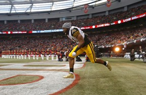 Hamilton Tiger Cats' Simoni Lawrence is introduced during ceremonies ahead of the start of the CFL's 102nd Grey Cup against the Calgary Stampeders in Vancouver on Nov. 30, 2014. (REUTERS/Todd Korol)