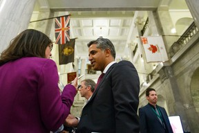Irfan Sabir (centre), Minister of Human Services, is interviewed in the rotunda after the government's delivery of Budget 2015 at the Alberta Legislature in Edmonton, Alta., on Tuesday October 27, 2015. Ian Kucerak/Edmonton Sun