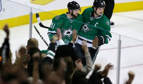 Dallas Stars' Tyler Seguin celebrates his goal with teammate Jamie Benn (14) during the third period of against the San Jose Sharks in Dallas on Oct. 31, 2015. (AP Photo/LM Otero)