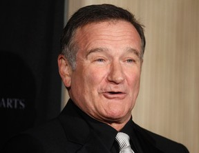 Actor Robin Williams poses as he arrives at the British Academy of Film and Television Arts Los Angeles Britannia Awards in Beverly Hills, California in this November 30, 2011 file photo. REUTERS/Fred Prouser/Files