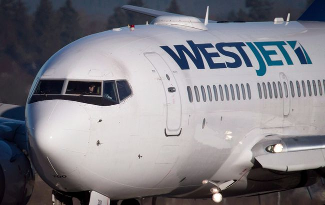A pilot taxis a Westjet Boeing 737-700 plane to a gate after arriving at Vancouver International Airport in Richmond, B.C., on Monday, February 3, 2014. THE CANADIAN PRESS/Darryl Dyck