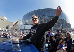 Royals manager Ned Yost waves to the crowd during a parade celebrating the Royals winning the World Series in Kansas City, Mo., on Tuesday, Nov. 3, 2015. The Royals beat the New York Mets in five games to win the championship. (Charlie Riedel/AP Photo)
