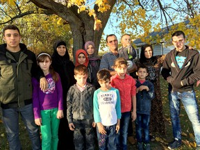 Photo courtesy of PEC Syria co-chairwoman Carlyn Moulton Members of the the Al Jassam family: Abdel Malek and his wife Sawsen, his mother Hadji, and their children Slieman, Ramez, Khatim, Ahmed, Rahef, Siham, Walaa, Alaa, Mijed, Bachar, and the baby Fadl pose for a photo Tuesday, Nov. 3, 2015.