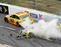 According to NASCAR, Matt Kenseth (right) intentionally wrecked Joey Logano at Martinsville Speedway on Sunday. For his actions, Kenseth was suspended two races and put on probation for six months. (AFP)
