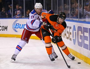 Sean Couturier suffered a concussion after taking a high hit Oct. 21 by former teammate Zac Rinaldo of the Boston Bruins. (USA TODAY SPORTS)