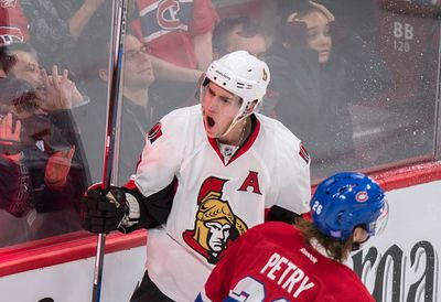 Ottawa Senators' Kyle Turris celebrates his game-winning goal as Montreal Canadiens' Jeff Petry, right, skates by during overtime NHL hockey action, in Montreal, on Tuesday, Nov. 3, 2015. THE CANADIAN PRESS/Paul Chiasson