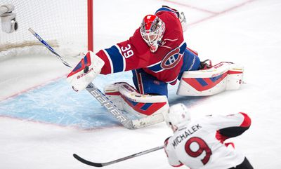 Montreal Canadiens' goalie Mike Condon deflects a shot from Ottawa Senators' Milan Michalek off his blocker during second period NHL hockey action, in Montreal, Tuesday, Nov. 3, 2015. THE CANADIAN PRESS/Paul Chiasson