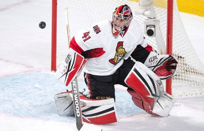 Ottawa Senators' goalie Craig Anderson keeps his eyes on the puck as he deflects a shot from the Montreal Canadiens during second period NHL hockey action, in Montreal, on Tuesday, Nov. 3, 2015. THE CANADIAN PRESS/Paul Chiasson