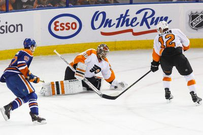 Philadelphia goaltender Michal Neuvirth (30) holds the puck and was given a delay of game penalty during the second period of a NHL game between the Edmonton Oilers and the Philadelphia Flyers at Rexall Place in Edmonton, Alta. on Tuesday November 3, 2015. Ian Kucerak/Edmonton Sun/Postmedia Network