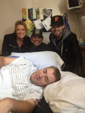 Country star Brett Kissel (right), along with QX104 morning hosts Brody Jackson and Samantha Stevens, made a surprise hospital visit to Derek McLennan last week.