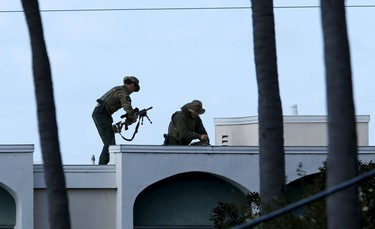 SWAT team officers set up their position at the scene of an active shooting with a suspect with a high powered rifle in the Bankers Hills section of San Diego, California, November 4, 2015. REUTERS/Mike Blake