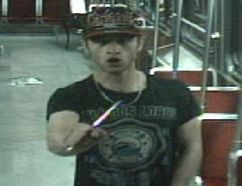 Sammy Yatim holds a knife while on a streetcar in Toronto on July 27, 2013 in this still taken from court handout surveillance video.