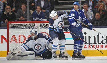 TORONTO, ON - NOVEMBER 4: Ondrej Pavelec #31 of the Winnipeg Jets makes a save against the Toronto Maple Leafs during an NHL game at the Air Canada Centre on November 4, 2015 in Toronto, Ontario, Canada.   Claus Andersen/Getty Images/AFP == FOR NEWSPAPERS, INTERNET, TELCOS & TELEVISION USE ONLY ==