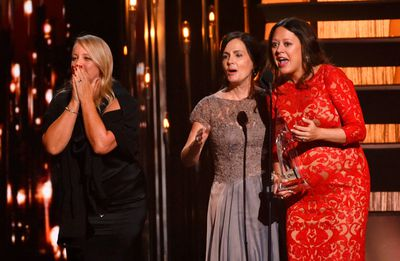 """Liz Rose, Hillary Lindsey and Lori McKenna (L to R) react as they accept the award for Song of the Year for Little Big Town's """"Girl Crush"""" at the 49th Annual Country Music Association Awards in Nashville, Tennessee November 4, 2015.  REUTERS/Harrison McClary"""