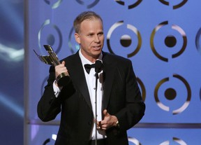 """Actor Gerry Dee accepts the awards for best actor in a comedy series role for his work in """"Mr. D"""" at the Canadian Screen Awards in Toronto March 3, 2013.  (REUTERS/Mark Blinch)"""