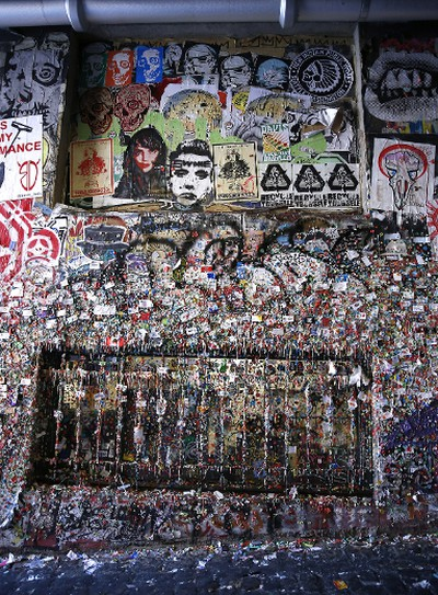 The gum wall at Seattle's Pike Place Market is scheduled for its first deep clean in 20 years. Although the market cleans the curious tourist attraction every other month with a steamer, this is the first time anyone has tackled the gum's complete removal from the original wall, the Times reports. The job is expected to cost $4,000. Market officials know that avid chewers are still likely to deposit their gum on the wall, but they're hoping the clean-up helps contain its spread across the market's historic walls.  Featuring: Gum Wall Where: Seattle, Washington, United States When: 04 Nov 2015 Credit: Judy Eddy/WENN.com