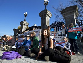 Environmental activists, including Lucy Lambert (front right) sit outside the main entrance to the grounds of Rideau Hall, where Prime Minister Justin Trudeau resides.  Thursday November 5, 2015. Errol McGihon/Ottawa Sun/Postmedia Network