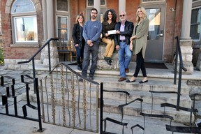 Silvia Langer, development director, Unity Project for Relief of Homelessness (centre), receives a $4,215 donation from the London Home Builders' Association on the front steps of the Unity Project's Dundas Street location in London Ont. November 3, 2015. Also pictured, from left to right: Stefanie Coleman-Dias, owner, Coleman-Dias Construction, Peder Madsen, co-owner, CCR Building & Remodeling Inc., Patrick Malloy, owner, Duo Building Ltd., and Anita Schipper, communications officer, Unity Project. CHRIS MONTANINI\LONDONER\POSTMEDIA NETWORK