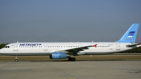 The Metrojet's Airbus A-321 with registration number EI-ETJ that crashed in Egypt's Sinai peninsula, is seen in this picture taken in Antalya, Turkey September 17, 2015. The Russian airliner carrying 224 passengers and crew crashed in Egypt's Sinai peninsula on October 31, 2015, the Egyptian civil aviation authority said, and a security officer who arrived on the scene said all aboard the plane were probably dead. The Airbus A-321, operated by Russian airline Kogalymavia with the flight number 7K9268, was flying from the Sinai Red Sea resort of Sharm el-Sheikh to St Petersburg in Russia when it went down in a desolate mountainous area of central Sinai soon after daybreak, the aviation ministry said. Picture taken September 17, 2015. (REUTERS/Kim Philipp Piskol)
