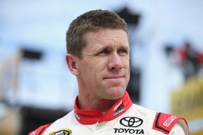 Carl Edwards, driver of the #19 Sport Clips Toyota, stands in the garage area during practice for the NASCAR Sprint Cup Series AAA Texas 500 at Texas Motor Speedway on November 6, 2015 in Fort Worth, Texas.  (Sean Gardner/AFP)