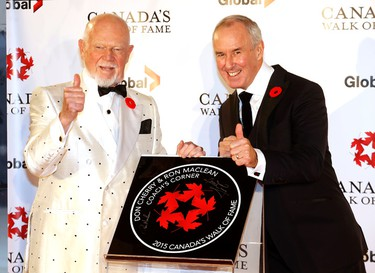 Don Cherry and Ron MacLean with their plaque as they were inducted into the Canadian Walk of Fame at the Sony Centre in Toronto on Nov. 7, 2015. (Michael Peake/Toronto Sun)