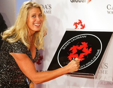 Athlete Silken Laumann signs her plaque as she was inducted into Canada's Walk of Fame at the Sony Centre in Toronto on Nov. 7, 2015. (Michael Peake/Toronto Sun)