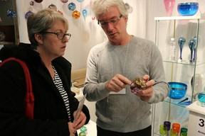 Wellington hot glass artist Mark Armstrong shows some of his work to Connie Howell of Brighton at The Makerís Hand artisan show in Picton on the weekend.