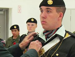 Buster Thiel, of the Petrolia Army Cadet corps,l receives the Major General Howard Award in Petrolia recently. The award ranks Thiel as this year's top cadet in Ontario. Handout/Sarnia Observer/Postmedia Network Cadet league of Ontario)