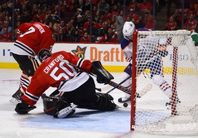 Oilers winger Teddy Purcell fails to score on a rebound against Blackawks goaltender Corey Crawford Sunday in Chicago. (USA TODAY SPORTS)