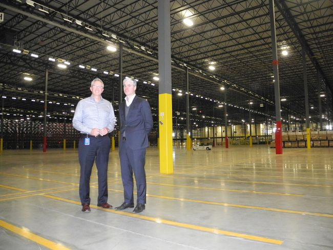 <p>Walmart senior director of operations Drew Robertson, left, and senior director of corporate affairs Alex Roberton stand in one of the cavernous storage rooms at the new Walmart perishable distribution centre on Industrial Drive on Monday November 9, 2015 in Cornwall, Ont.</p><p> Greg Peerenboom/Cornwall Standard-Freeholder/Postmedia Network